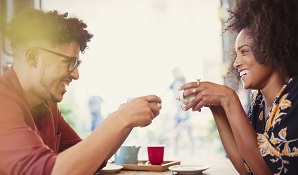 man and woman having coffee together
