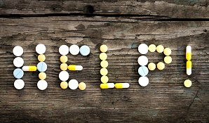 help spelled out with pills