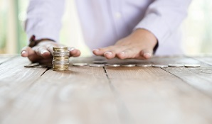 man counting coins on table