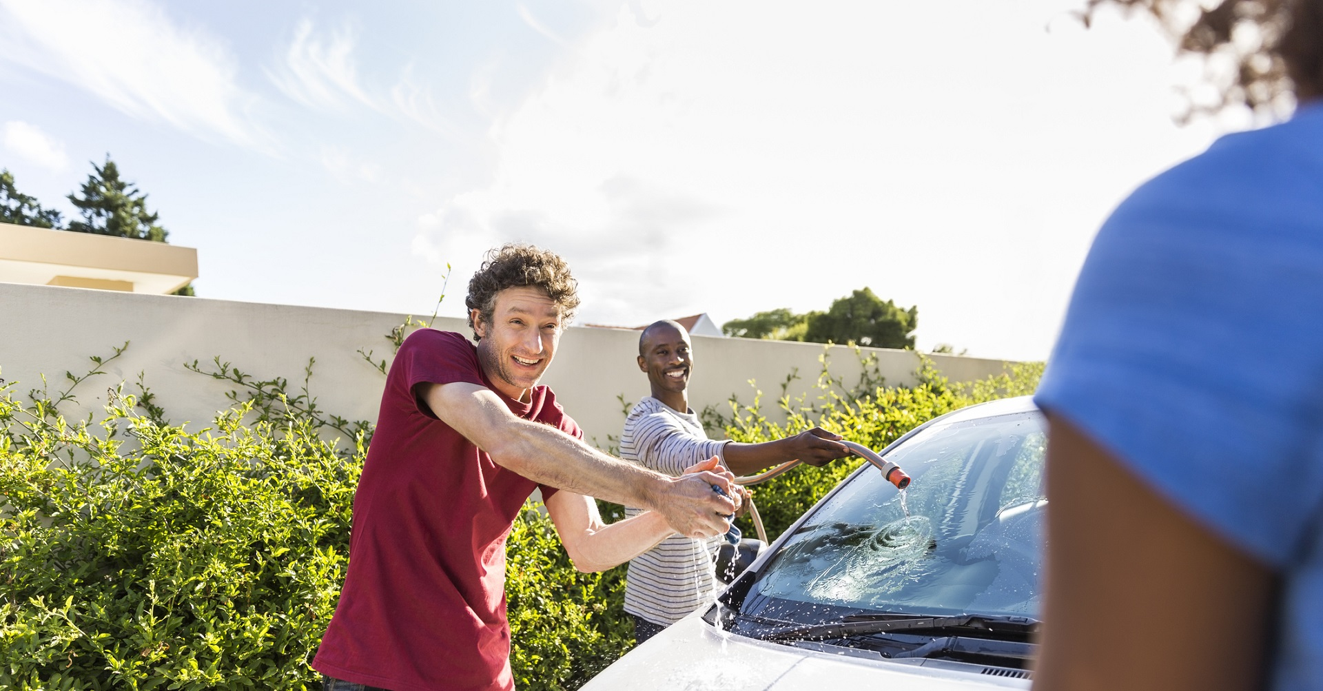 friends washing a car