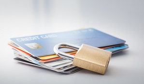 credit cards on table with padlock