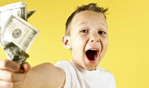 kid holding money with excitement on face