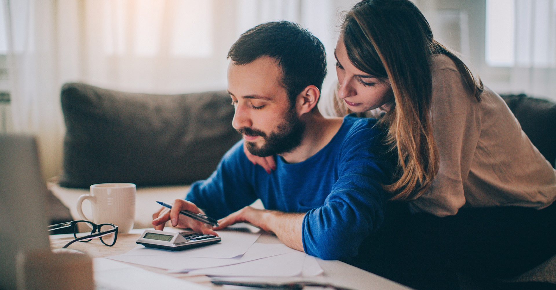 Couple sitting at desk working out finances