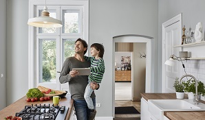 man with son standing in the kitchen