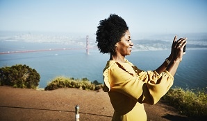woman taking photos by golden gate bridge
